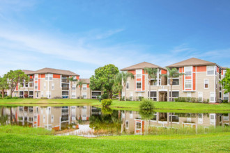 Palm Cove Apartments Buildings and Pond